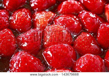 Closeup of a decadent chocolate strawberry tart.