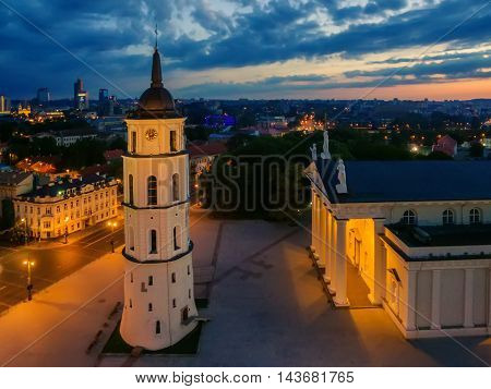 Aerial top night view of Old Town in Vilnius, Lithuania: the cathedral in sunrise