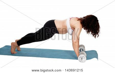A young woman doing punch-up's on a blue matt with curly brunette hair wearing exercise outfit isolated for white background.
