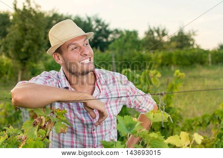Happy Male Farmer At The Vineyard