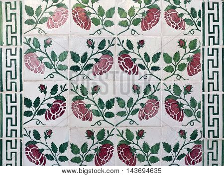 Detail of traditional decorative tiles covering many external walls in the Alfama district in Lisbon Portugal