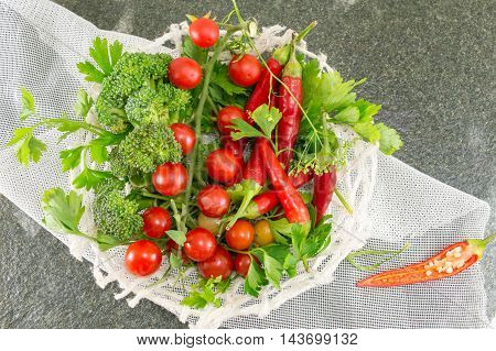 Cherry Tomato And Red Pepper On Stone Background