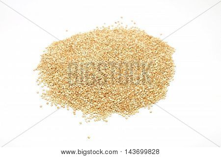 Quinoa grains pile isolated on white background