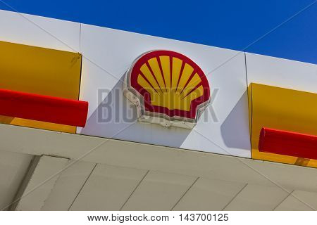 Indianapolis - Circa August 2016: Signage and Logo of Shell Gasoline. Royal Dutch Shell plc is based in The Hague Netherlands II
