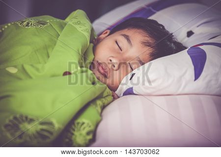 Healthy Child. Little Asian Boy Sleeping Peacefully On Bed. Vintage Tone Effect.