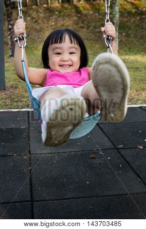Asian Little Chinese Girl Playing Swing