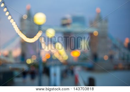 Blur background of Tower bridge.  London at sunset, panoramic view of modern skyscrapers and city lights
