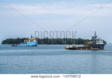 Labuan,Malaysia-Aug 19,2016:The Supply vessel transporting cargo at Labuan port.Labuan strategically located in the hub of Asia-Pacific and the ASEAN offshore oil exploration and production region.