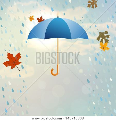 Blue Opened Umbrella With Rain And Falling Leaves