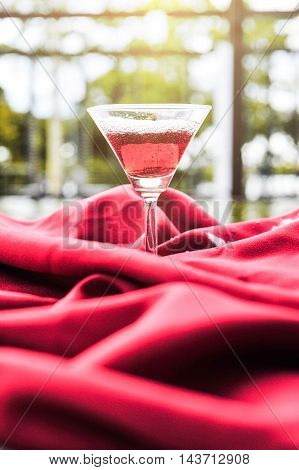 Wine Glass With Red Wine On A Red Cloth.