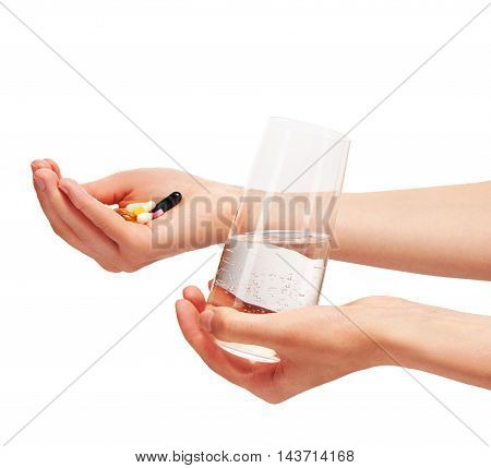 Hands Holding Glass With Water And Tablets And Capsules