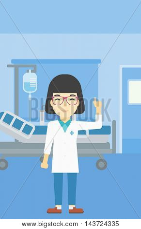 An asian female doctor in medical gown showing finger up. Doctor with finger up in the hospital ward. Woman in doctor uniform pointing finger up. Vector flat design illustration. Vertical layout.