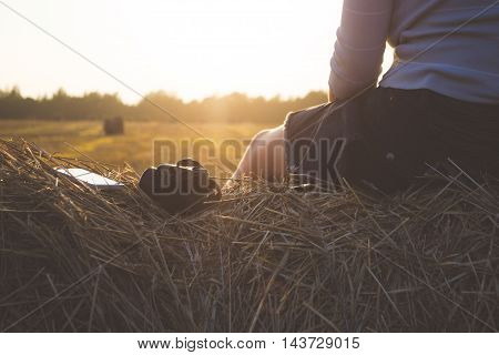 Girl outdoors looking at white mobile phone