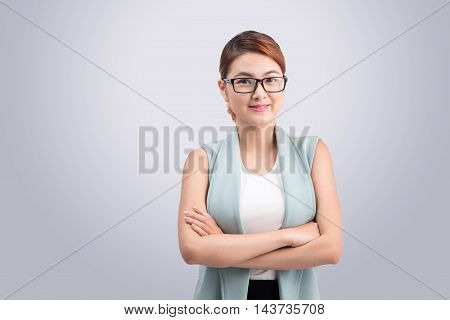 Beautiful asian young business woman on grey background.