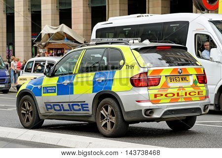 LONDON UK - JULY 8 2016: London Metropolitan Police vehicle in the City of London. The Met was formed in 1829 and as of 2011 employed 48661 staff making it one of biggest employers in London.