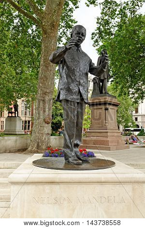 LONDON ENGLAND - JULY 8 2016: Staue of historic South African leader Nelson Mandela on Parliament Square.