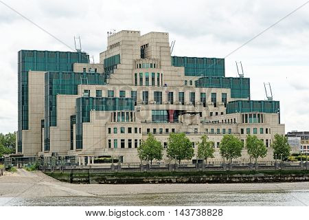 LONDON ENGLAND - JULY 8 2016: The Secret Intelligence Service building known as MI6 featured in a James Bond film and located on the bank of the River Thames beside Vauxhall Bridge.