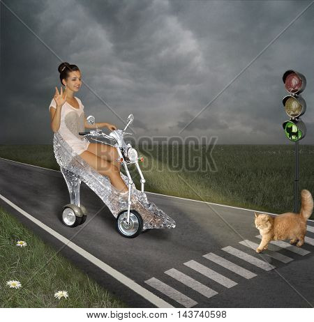 A girl is riding on a motorcycle. It looks like a glass slipper. A red cat goes across the road.