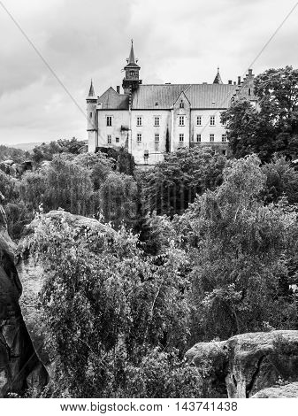 Medieval Castle Hruba Skala situated on a steep sandstone cliff in Bohemian Paradise, or Cesky Raj, Czech Republic . Black and white image.