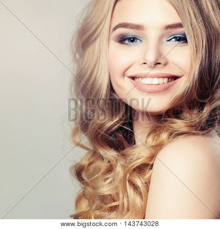 Cute Girl. Healthy Skin and Hair. Beauty Face on Background