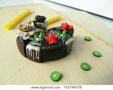 Miniature Polymer Clay Strawberry And Kiwi Cake On The Table