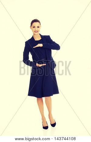 Business woman showing something or copyspase