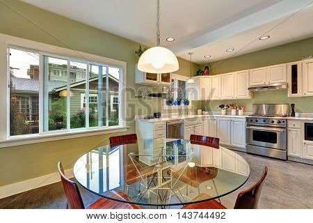 View Of Dining Table Set And Kitchen Storage Combination.