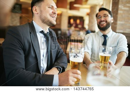 Businessman Laughing in Bar
