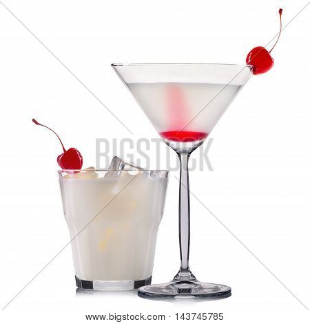 Set of white cocktails with cherry and black straw isolated on white background.