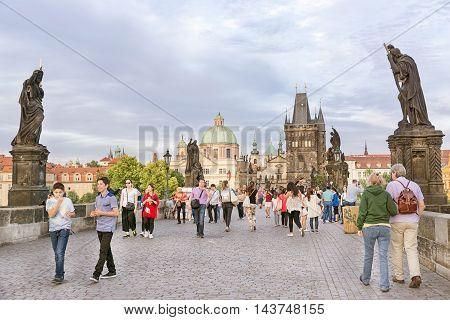 PRAGUE, CZECH REPUBLIC, JULY 7,2016: People walking on Charles Bridge, a famous historic bridge that crosses the Vltava river in Prague, Czech Republic.