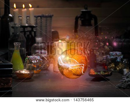 Golden Sphere. Magic items. Flasks retort for alchemy. Beautiful glow. Concept - the magician mystic paranormal phenomena. Occult esoteric spiritualism calling the spirits and ghosts poster