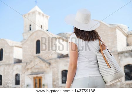 Teenage girl with a map on a city tour. Young and beautiful woman have a weekend in Larnaca. Vacation, holidays and traveling concept.