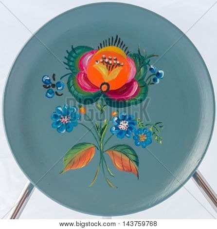 Rosemåling or rosemaling is the name of a traditional form of decorative folk art that originated in the rural valleys of Norway