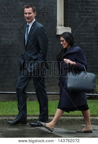 LONDON, UK, FEB 2, 2016: Jeremy Hunt MP and Priti Patel MP seen arriving at Downing Street for a cabinet meeting