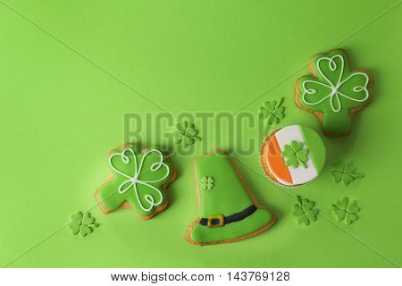 Cupcake and cookies on green background. Saint Patrics Day concept