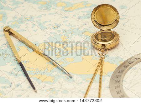 Navigation still-life. Skipper equipment and a map. Sailing concept.