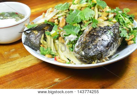 deep fried striped snake head fish with mixed herb and sweet sauce