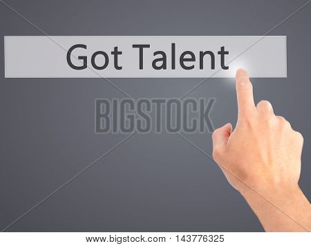 Got Talent - Hand Pressing A Button On Blurred Background Concept On Visual Screen.