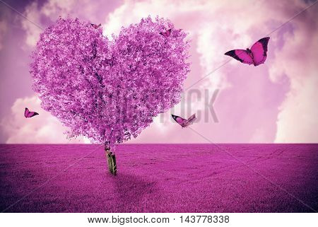 Beautiful field with heart shape tree and butterflies. Abstract pink landscape background.