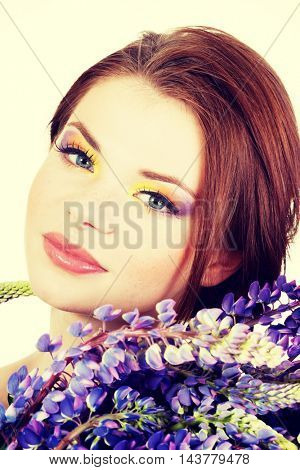 Beutiful young woman with colorful makeup
