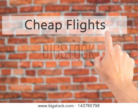 Cheap Flights - Hand Pressing A Button On Blurred Background Concept On Visual Screen.