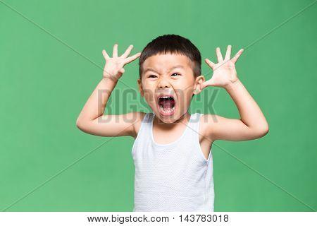 Little boy showing a grimace