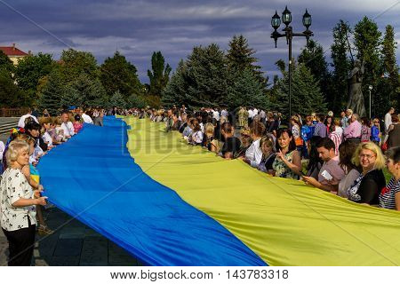 Uzhgorod Ukraine - August 23. 2016: The participants of the celebrations of the Day of State Flag of Ukraine shall be a 100-meter blue-yellow flag of the city streets.