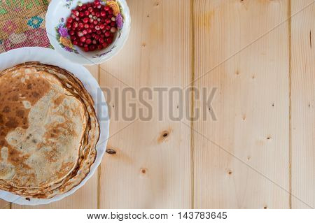Delicious Rustic Fragrant Pancakes With Lingonberries. Top View. Flat Lay