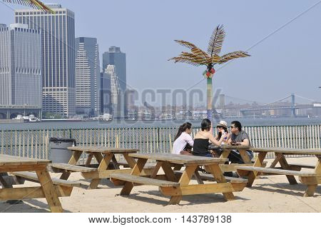 GOVERNORS ISLAND, NEW YORK, NEW YORK - May 27 2011: Visitors relax on a sunny day at Governors Island.