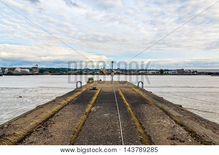 Disused concrete jetty along river near Thames Barrier