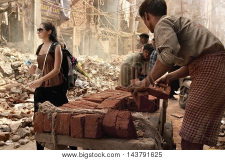 PAHARGANJ, NEW DELHI, INDIA - 8 Aug 2010: A tourist walks through a section of the city undergoing renovations for the 2010 Commonwealth Games.