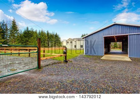 Farm blue barn shed and gravel driveway. Northwes USA poster