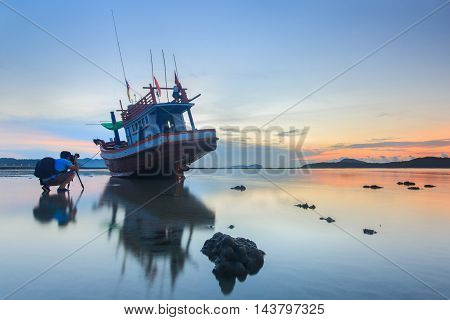 Photographer take a photo sunrise at the Rawai beach in Phuket Thailand