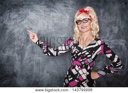 Retro Teacher In Glasses Showing On Something By Finger
